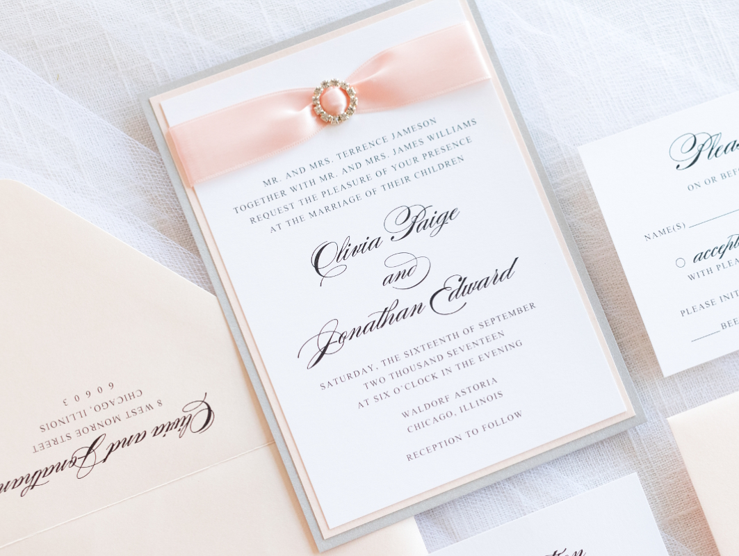 elegant & formal wedding invitation with satin ribbon and rhinestone crystal embellishment in white, silver, and blush shimmer
