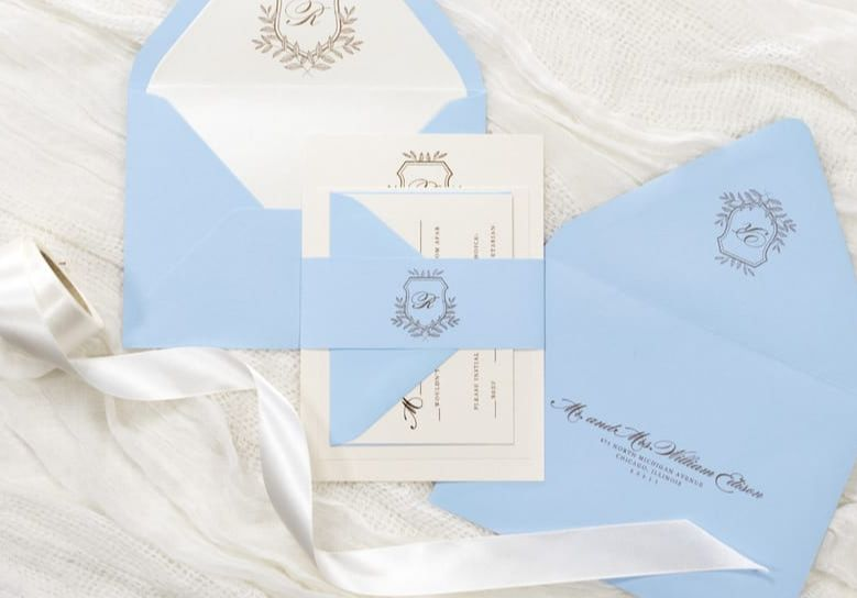 Picturepale / serenity blue and opal shimmer wedding invitation with gold foil printing and formal wedding crest monogram