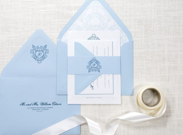 pale / serenity blue and ice silver wedding invitation with ornate crest monogram