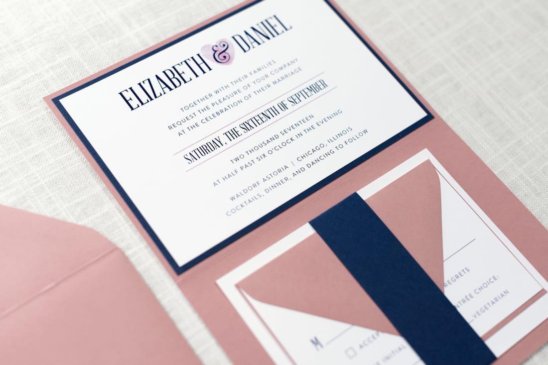folding wedding invitation with thumbprint heart design in white, dusty rose, and navy blue
