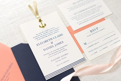 Elegant and Formal Nautical Sliding Pocket Wedding Invitation with Anchor Charm Ribbon Embellishment in Ivory, Navy Blue, Coral, and Antique Gold - Chicago Wedding Invitations