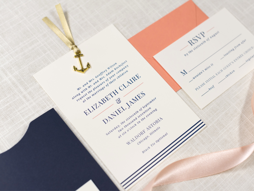 ELEGANT AND FORMAL NAUTICAL SLIDING POCKET WEDDING INVITATION WITH ANCHOR CHARM RIBBON EMBELLISHMENT IN IVORY, NAVY BLUE, CORAL, AND ANTIQUE GOLD