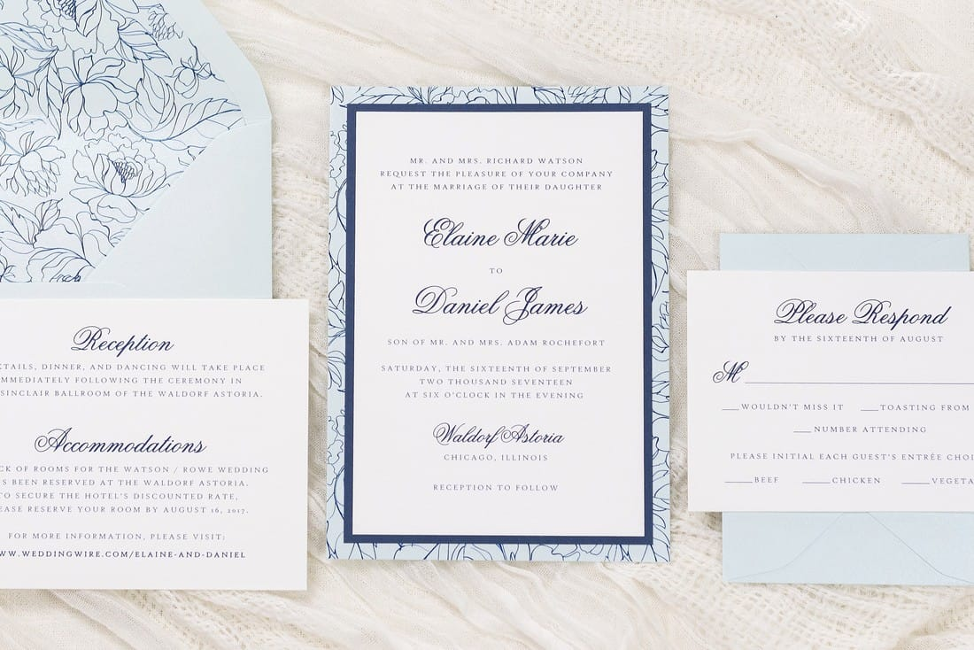 delicate floral layered wedding invitation in white, aqua, and navy