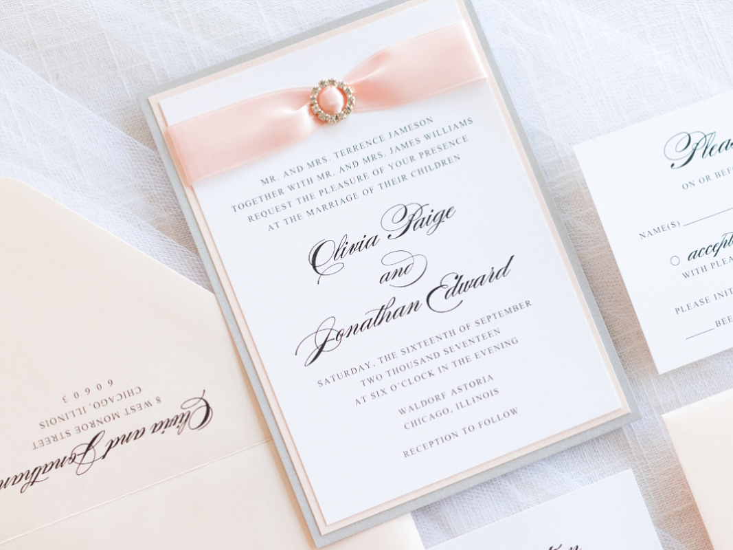dazzling-elegant-formal-wedding-invitation-with-satin-ribbon-and-rhinestone-crystal-embellishment-in-white-silver-and-blush-shimmer_1