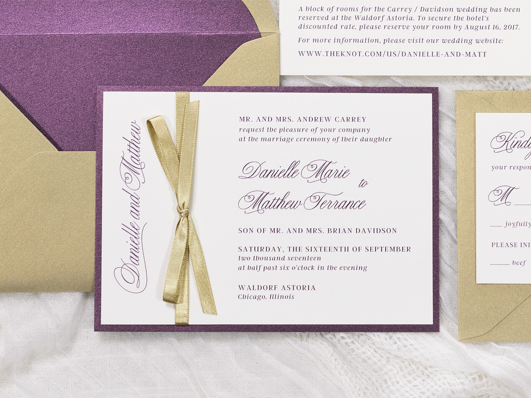 ELEGANT AND FORMAL WEDDING INVITATION IN GOLD SHIMMER, MERLOT, IVORY WITH A GOLD RIBBON BOW EMBELLISHMENT AND ENVELOPE LINER