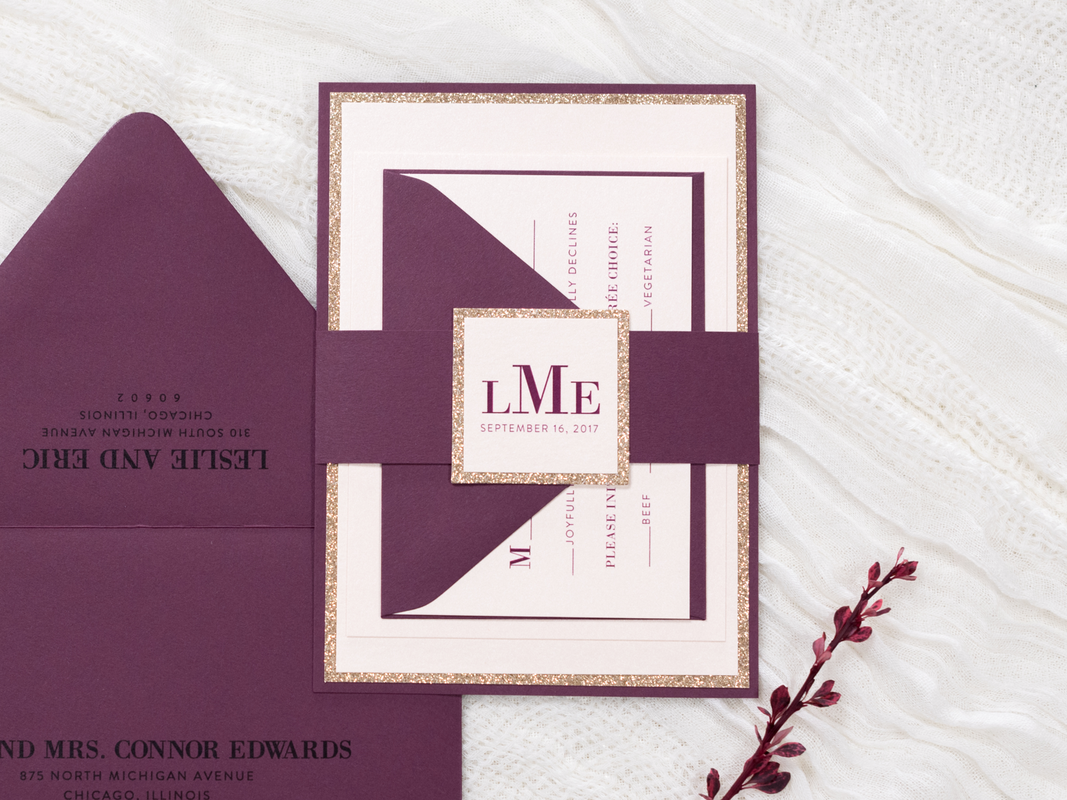 Elegant and Formal Layered Wedding Invitation with Rose Gold Glitter Cardstock, Blush Shimmer, and Burgundy Maroon Embellished with a Belly Band and Glitter Monogram Square