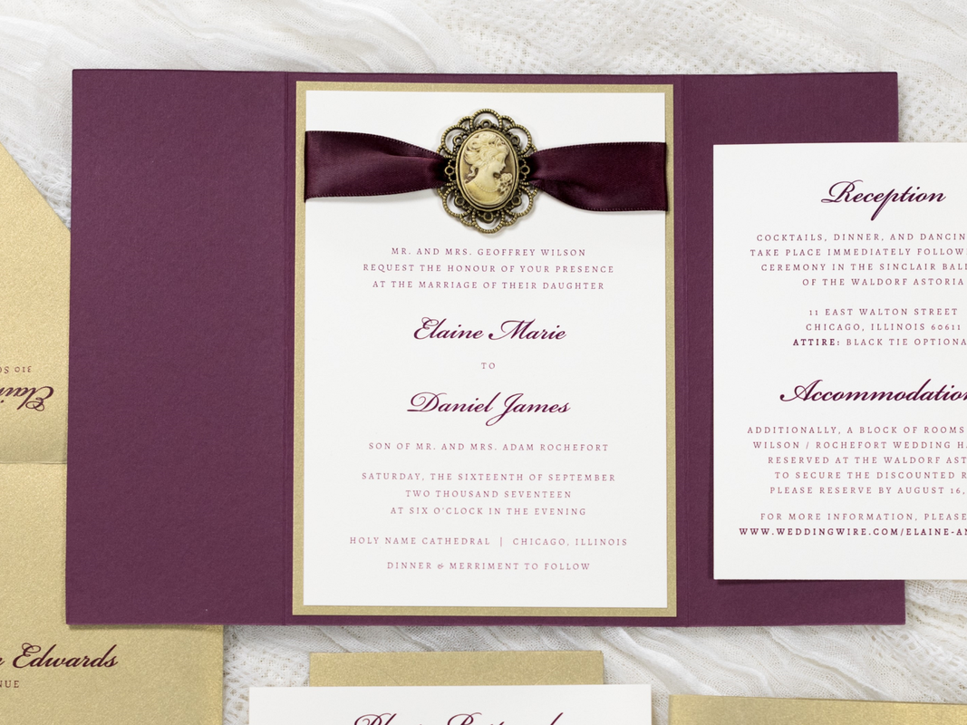 ELEGANT AND FORMAL GATEFOLD WEDDING INVITATION WITH VINTAGE STYLE CAMEO SILHOUETTE RIBBON EMBELLISHMENT IN IVORY, GOLD LEAF, AND WINE BURGUNDY