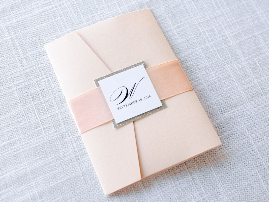 elegant-formal-white-silver-glitter-and-blush-metallic-shimmer-pocketfold-wedding-invitation-suite-with-satin-ribbon-belly-band-monogram-1_1_orig
