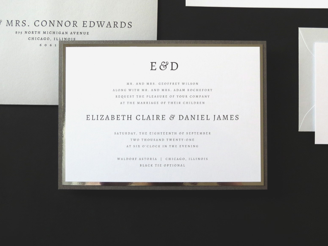 MODERN AND FORMAL LAYERED WHITE, SILVER FOIL, COOL GREY AND DARK GREY SHIMMER WEDDING INVITATION WITH ELEGANT MODERN MONOGRAM