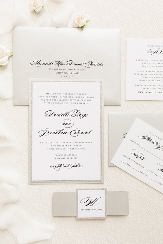 elegant and formal silver glitter, silver metallic shimmer, and white wedding invitation with belly band monogram square
