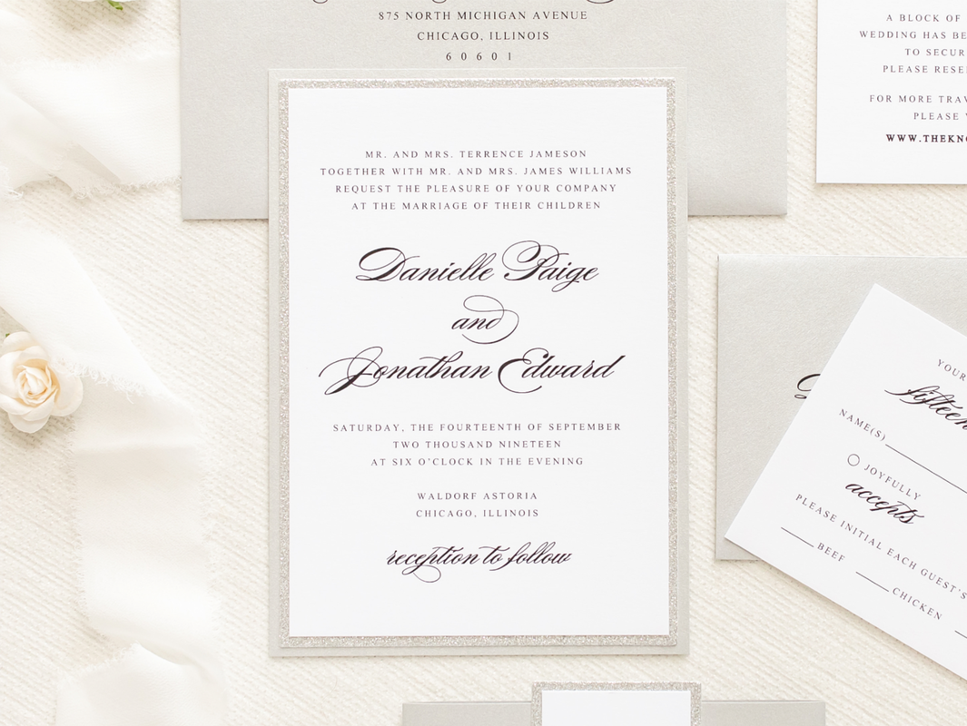 ​elegant and formal silver glitter, silver metallic shimmer, and white wedding invitation with belly band monogram square