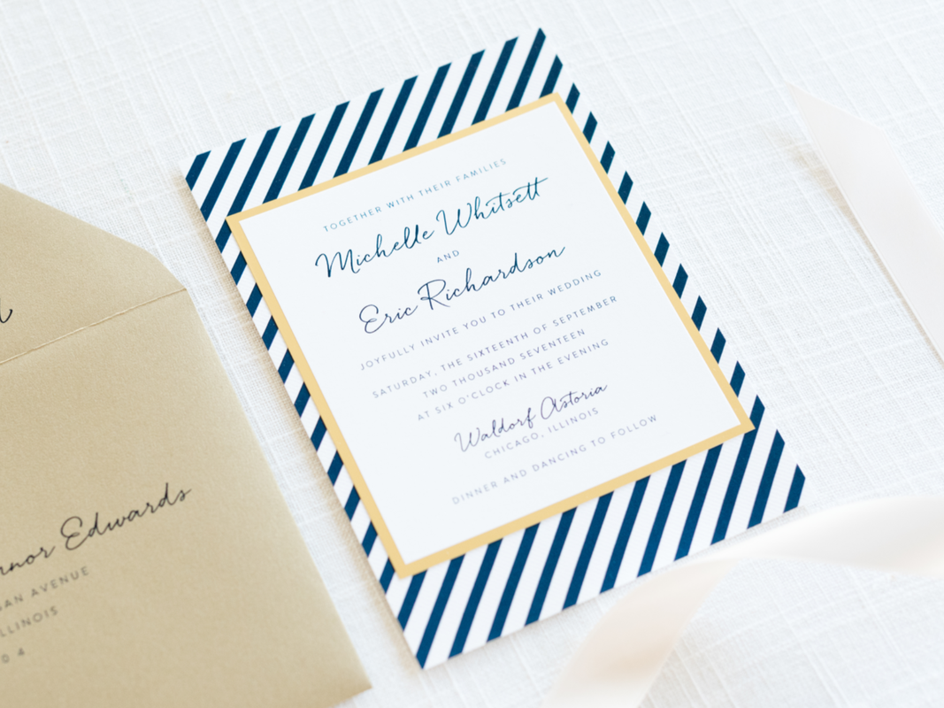 Modern Nautical Wedding Invitation layered with Navy Blue Striped Pattern, Gold Foil, and White with Gold Leaf Envelopes