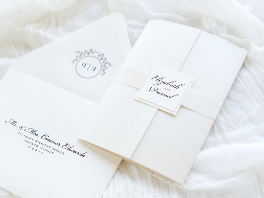Elegant and Formal Gatefold Wedding Invitation with Ribbon Belly Band and Wedding Crest Monogram Square Embellishment - Ivory, Opal Champagne Shimmer, and Ivory Satin Ribbon