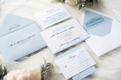 chicago skyline elegant and formal wedding invitation with chicago theatre marquee - pale blue, serenity blue, white, and quartz shimmer wedding invitation suite