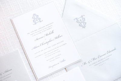 elegant & formal wedding invitation with monogram crest design in white, light dusty blue cool grey