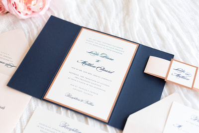 elegant & formal wedding invitation in navy blue, blush shimmer, rose gold foil, and ivory with gatefold and belly band