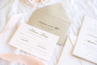 soft blush and gold shimmer luxury wedding invitation with elegant monogram crest and wax seal