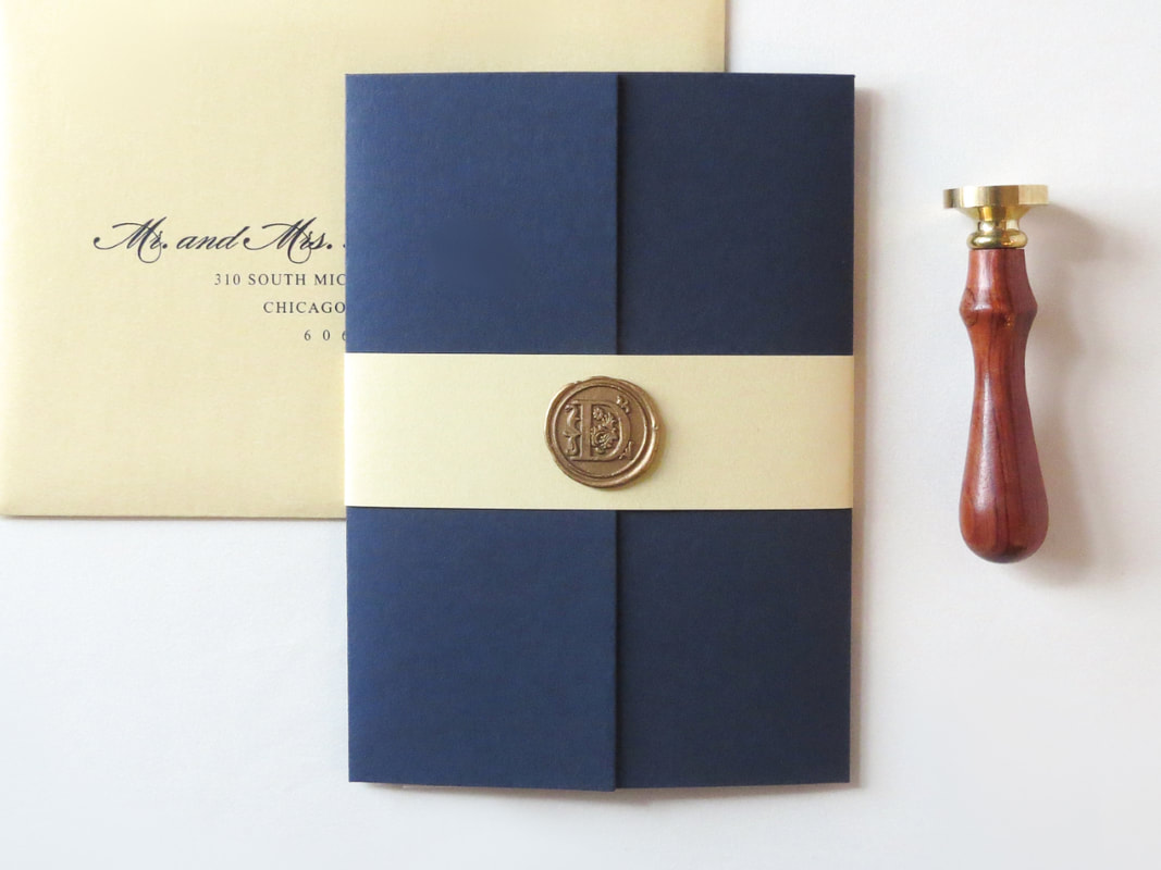 Elegant Formal Layered Gatefold Wedding Invitation with Paper Belly Band and Wax Seal Embellishment - Shown in Ivory, Night Navy Blue, Gold Shimmer, and Gold Wax Seal