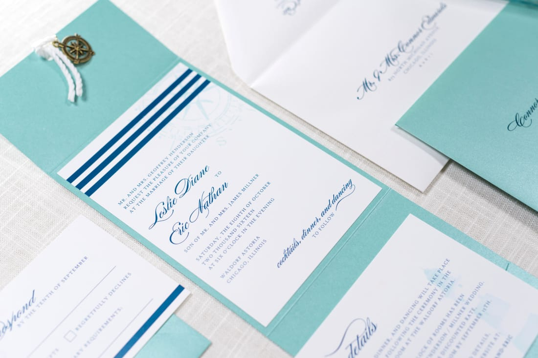 nautical compass charm and rope wedding invitation in white and teal / tiffany blue, and navy blue