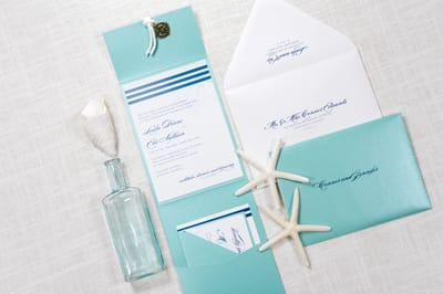 elegant and formal nautical compass charm and rope pocket fold wedding invitation in white and teal / tiffany blue, and navy blue - chicago wedding invitations