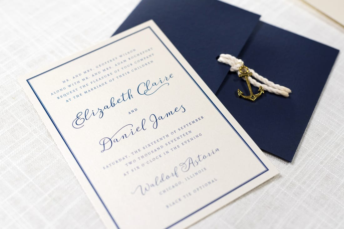 nautical anchor charm and rope wedding invitation in navy, ivory, and opal / champagne shimmer