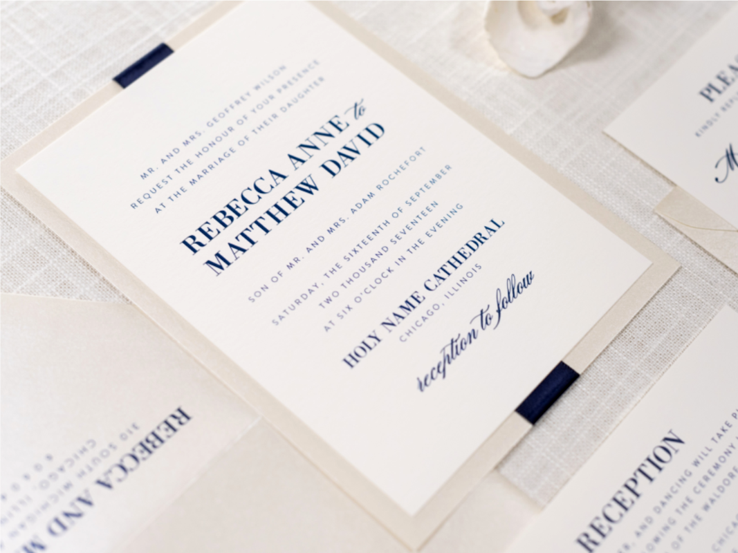 ELEGANT AND FORMAL OPAL CHAMPAGNE SHIMMER, IVORY, AND NAVY BLUE RIBBON ELEGANT WEDDING INVITATION
