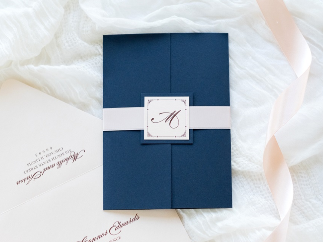 Elegant and Formal Gatefold Wedding Invitation with Ribbon Belly Band and Monogram Square Embellishment - Navy Night Blue, Blush Shimmer, and Blush Satin Ribbon