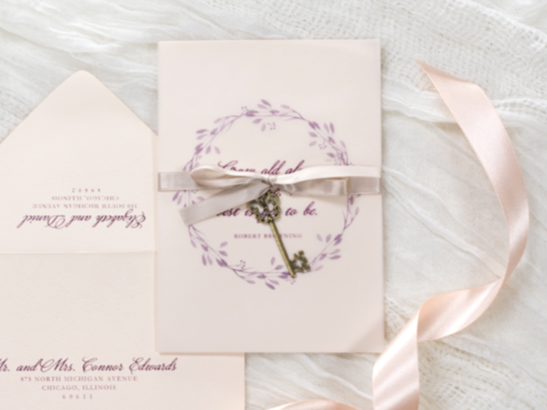 ELEGANT AND FORMAL VINTAGE STYLE KEY CHARM WEDDING INVITATION IN BLUSH, OPAL SHIMMER, AND BURGUNDY WITH VELLUM SHEET AND SATIN RIBBON
