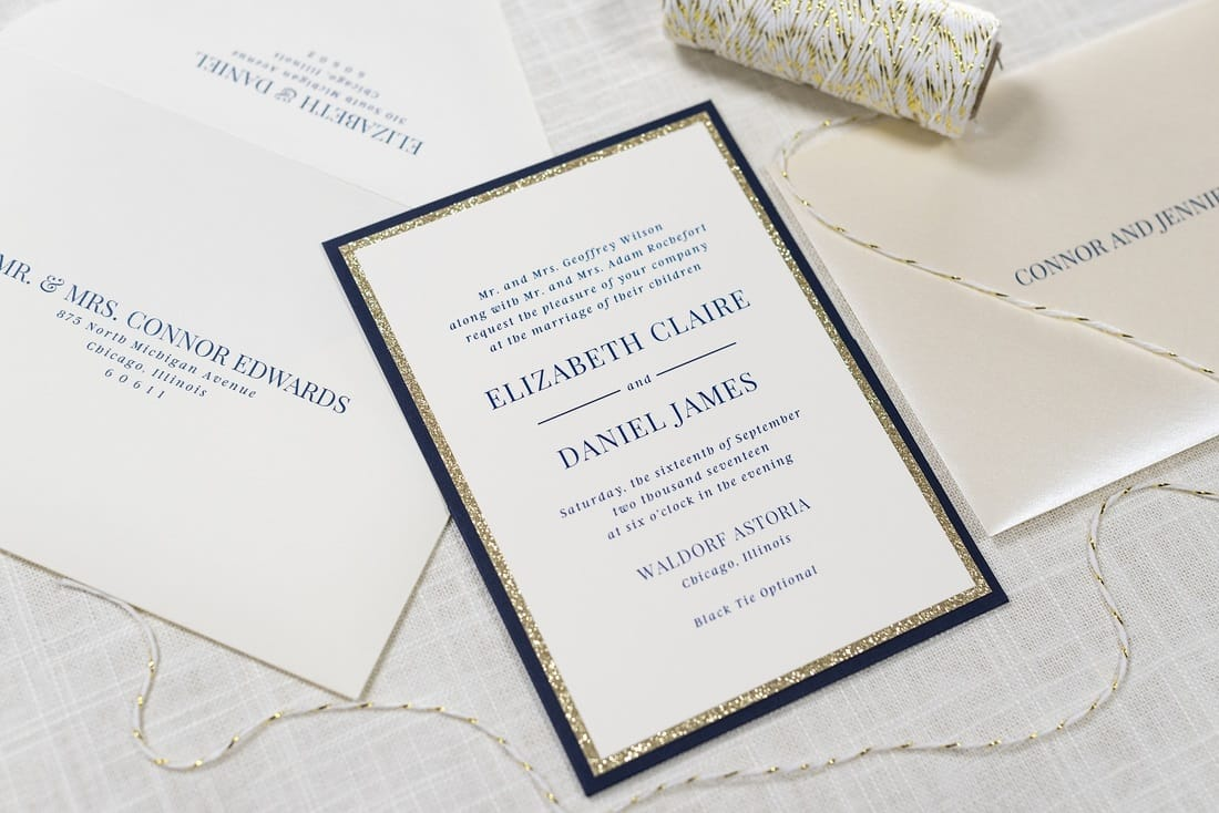 panel pocket wedding invitation in ivory, gold glitter, navy blue, and opal shimmer