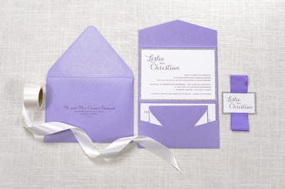 elegant and formal white, silver glitter and purple shimmer pocketfold wedding invitation with satin ribbon belly band and monogram